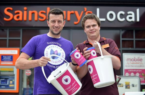 Christian Mellow from Sainsbury's with Dav Calogero from the Crocus Appeal outside the Great Horton Store