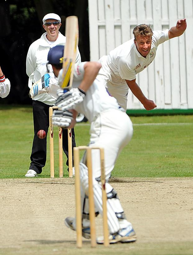 Bradford Telegraph and Argus: Woodlands' Pieter Swanepoel bowls to Cleckheaton's Tim Jackson