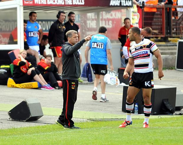 New Bulls coach James Lowes gives instructions from the dugout against Catalan