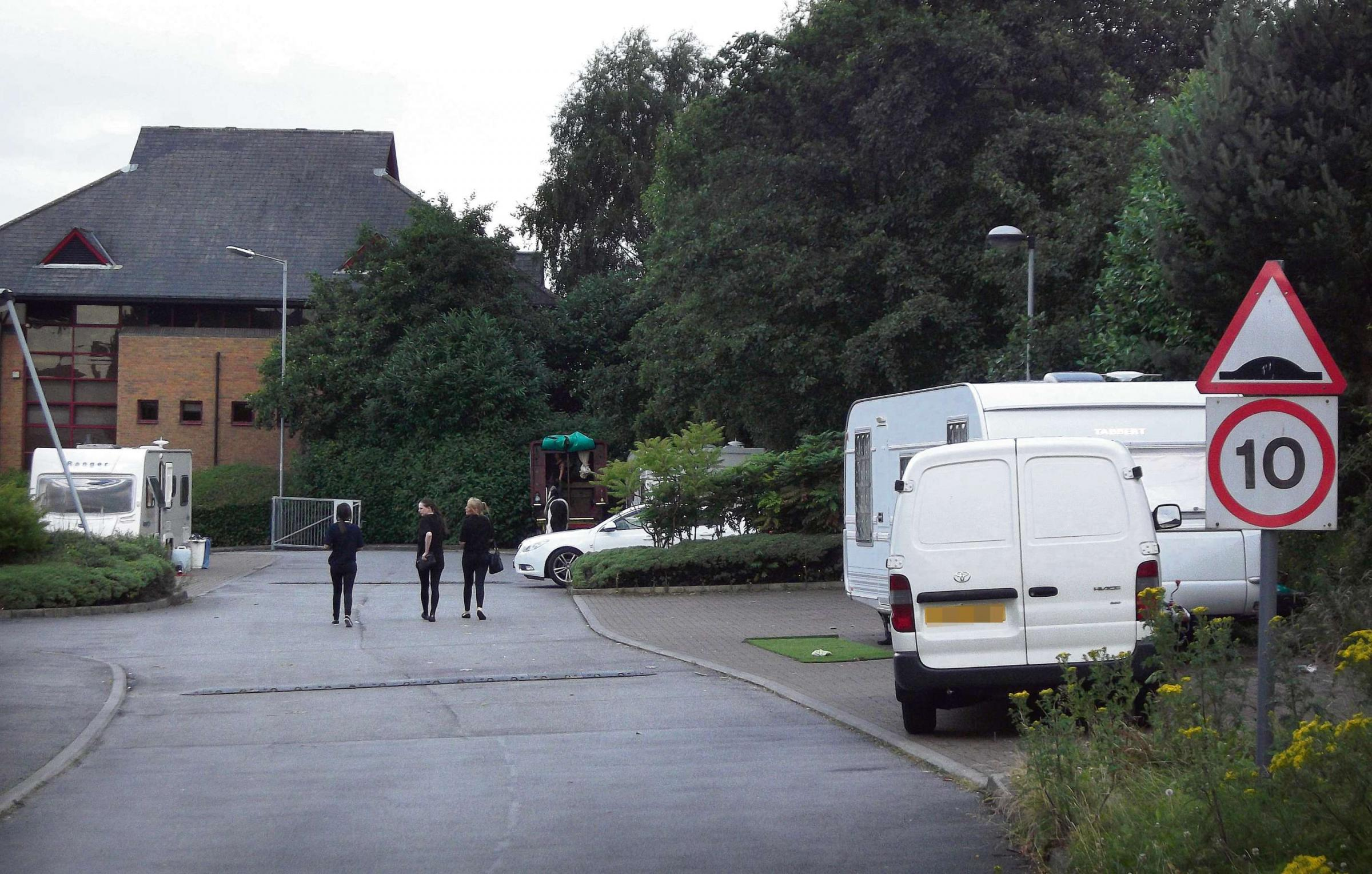 Travellers set up camp by Bradford hotel