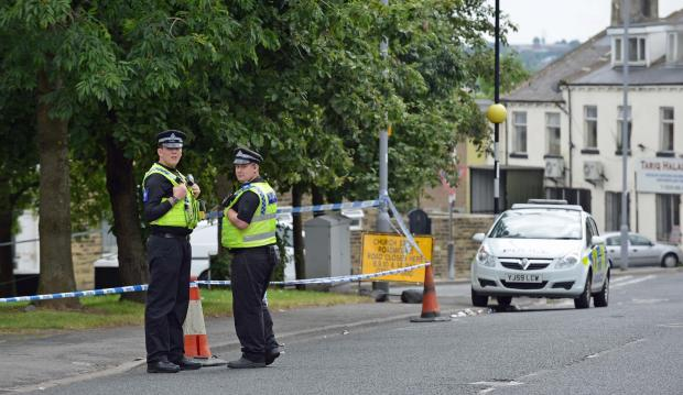 Bradford Telegraph and Argus: Police set up a cordon on Heaton Road after a shooting incident