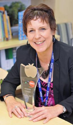 Jayne Clarke, of Ryecroft Primary Academy, with her award for being the country's best head teacher