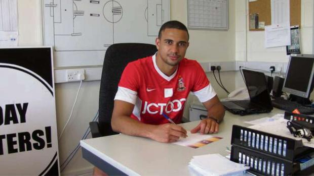 Bradford Telegraph and Argus: James Meredith signs his new contract at City's Apperley Bridge training base