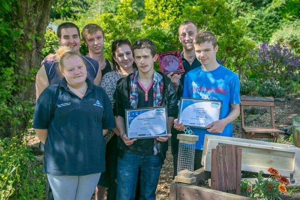 Woodville staff and students, Joe Wilkinson, Lauren Thorpe, Adam Craven (holding award), Jonathan Mathers, Charlotte Hainsworth and – holding certificates – Matthew Rainbow and Daniel Thompson, with some of the items they made on the right