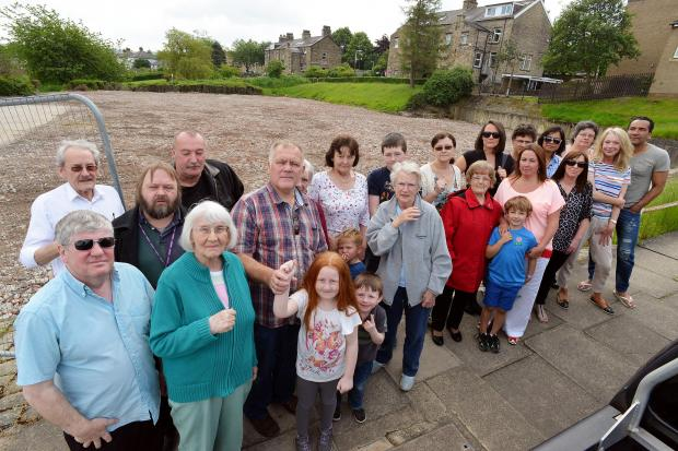 Bradford Telegraph and Argus: Protesters pictured last month at the former Neville Grange Centre site, Saltaire against the building of 65 apartments and increased traffic