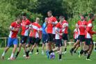 James Meredith (centre) back in the bunch at pre-season training