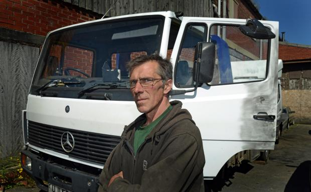 Bradford Telegraph and Argus: VICTIM: Eddie Sokulski with the recovery truck that was stolen and painted white.