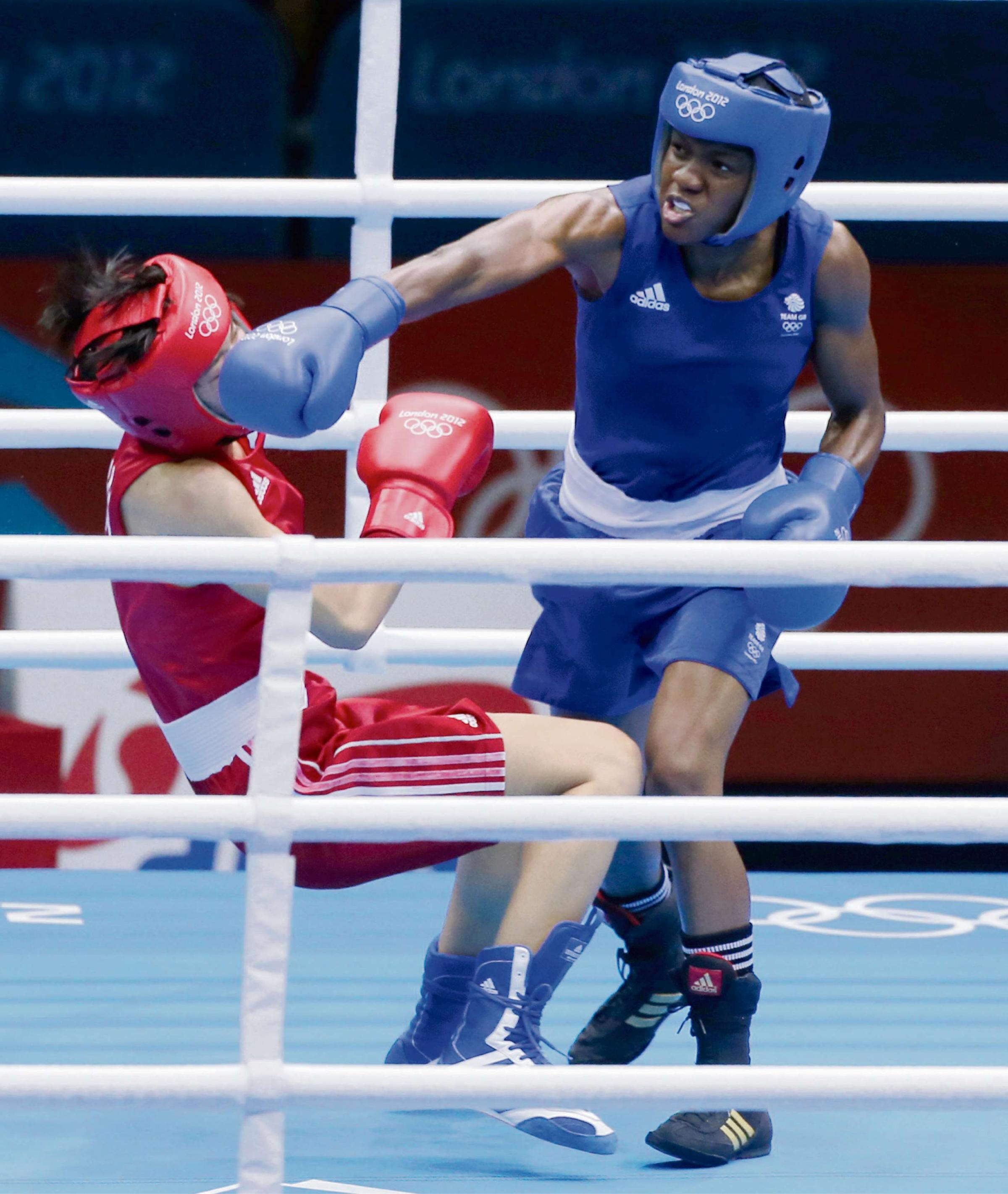 Nicola Adams knocks down Canacan Ren of China on her way to winning Olympic gold