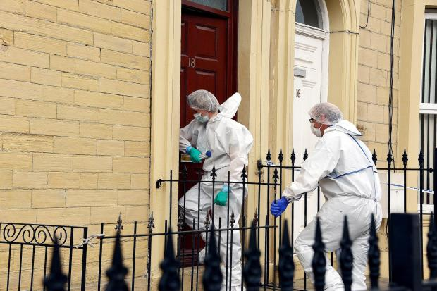 Bradford Telegraph and Argus: SEARCH: Forensic officers enter the house in Sawrey Place, Little Horton