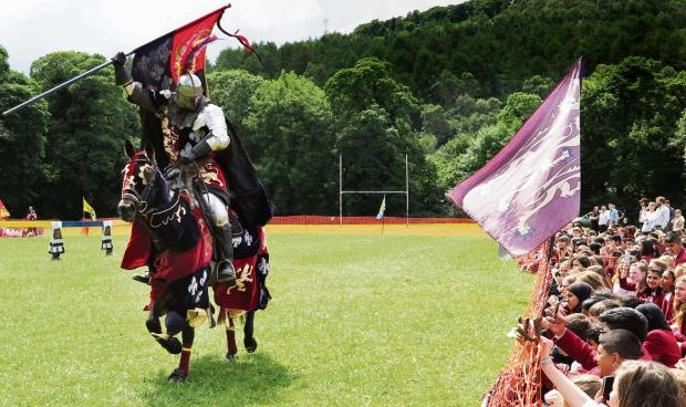 Primary pupils watch jousting as part of an Elizabethan day at Bingley Grammar School