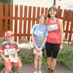Bradford Telegraph and Argus: Pictured after finishing the Tour de  Riddlesden fun run are, from left, Joshua, Zac and Elspeth Cansdale.