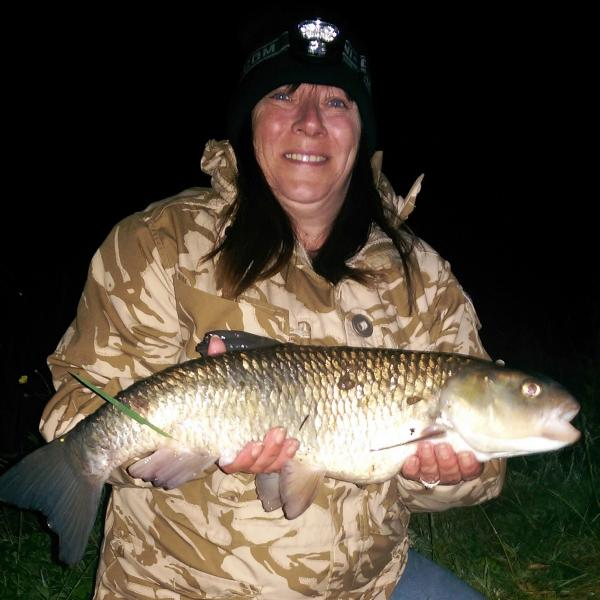New Bradford City Angling Association member Debbie Hardisty with her 7lb chub at Salmon Hall, caught on hair-rigged luncheon meat