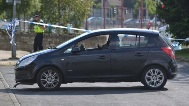 PROBE: The damaged car within the police cordon
