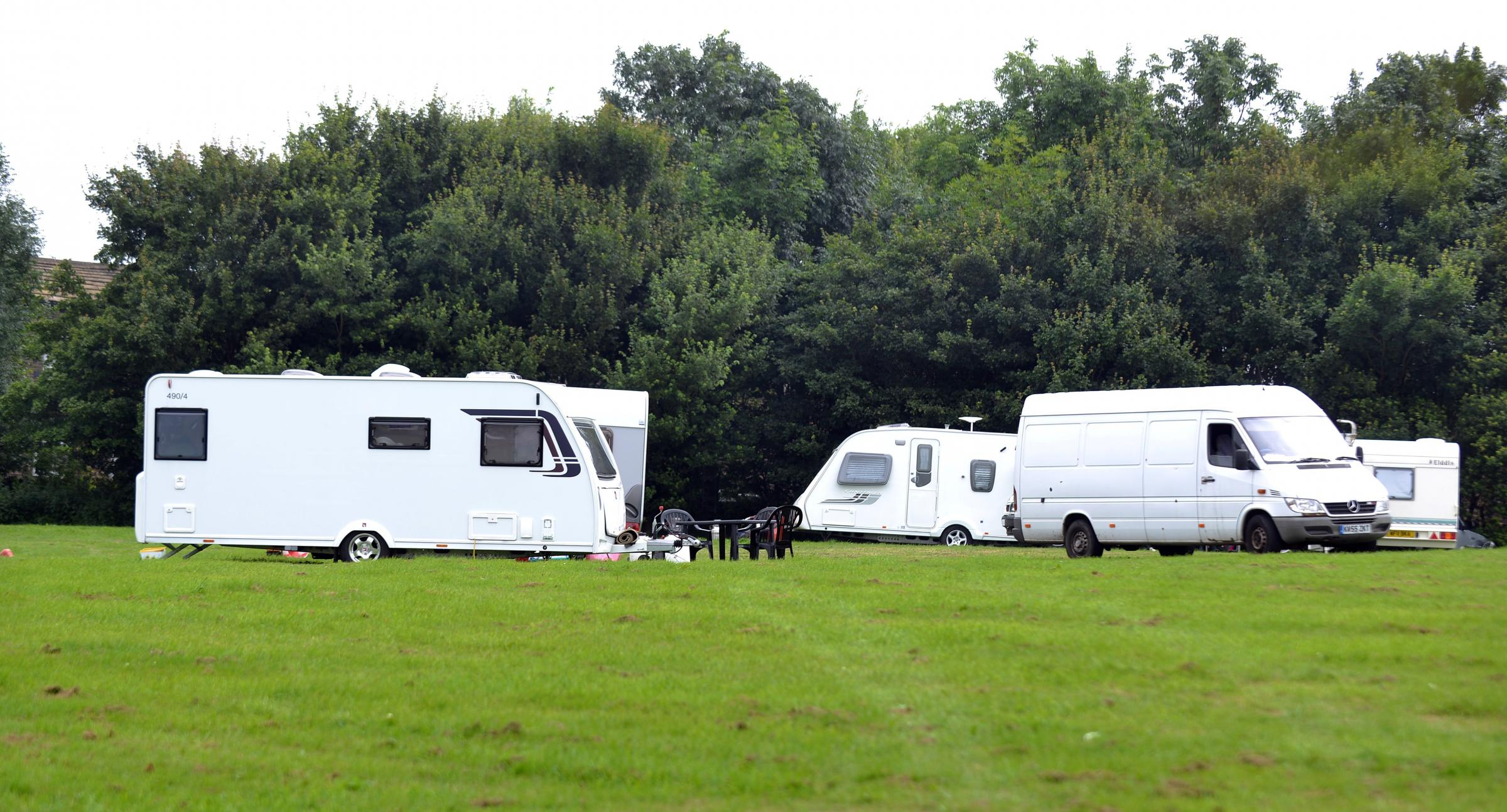 Travellers at the cricket ground in Clayton