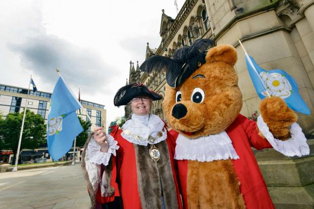 YORKSHIRE AND PROUD: The then Deputy Lord Mayor of Bradford, Councillor Joanne Dodds, with the Bradford Bear mascot, enjoying last year's Yorkshire Day.