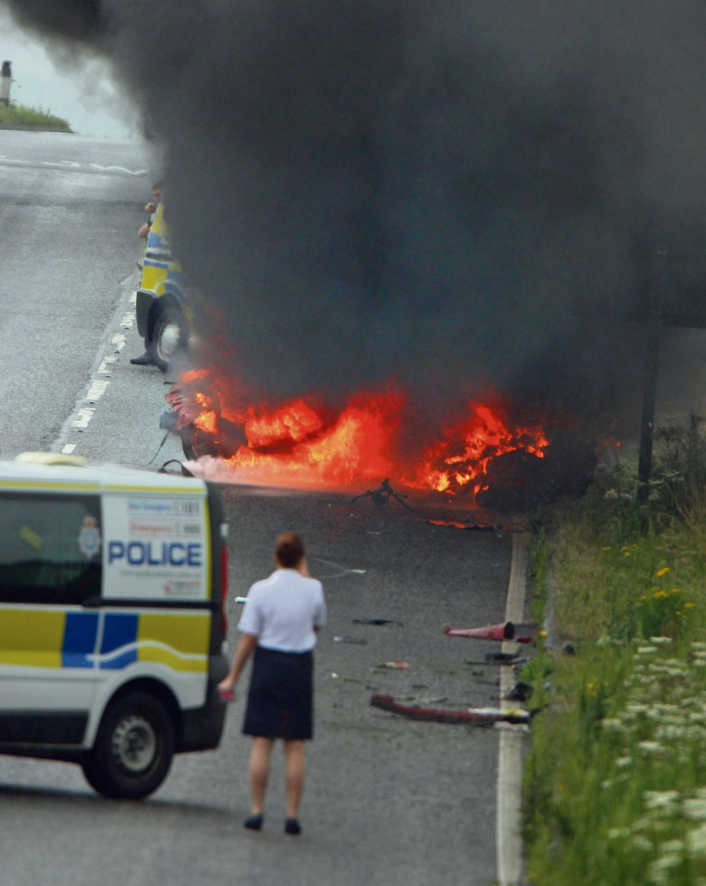 Driver escapes crash as car bursts into flames