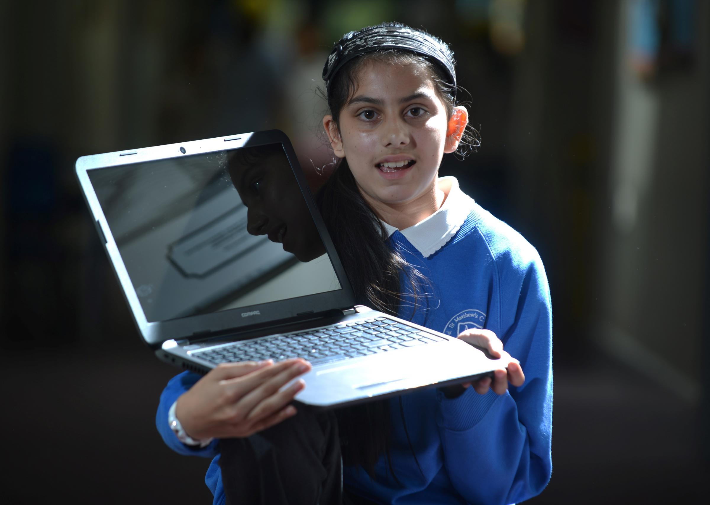 Laptop prize for pupil's perfect attendance