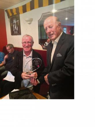 Tommy McCarthy, left, receives his memento from Norman Hudson
