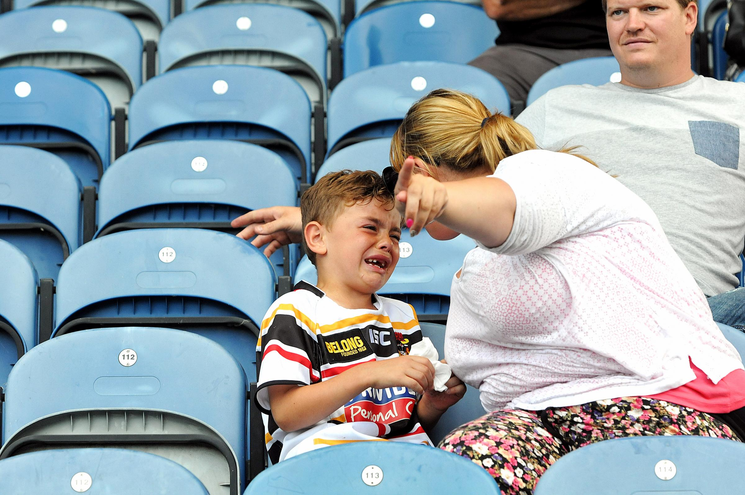 The picture that prompted an appeal to find the tearful young fan