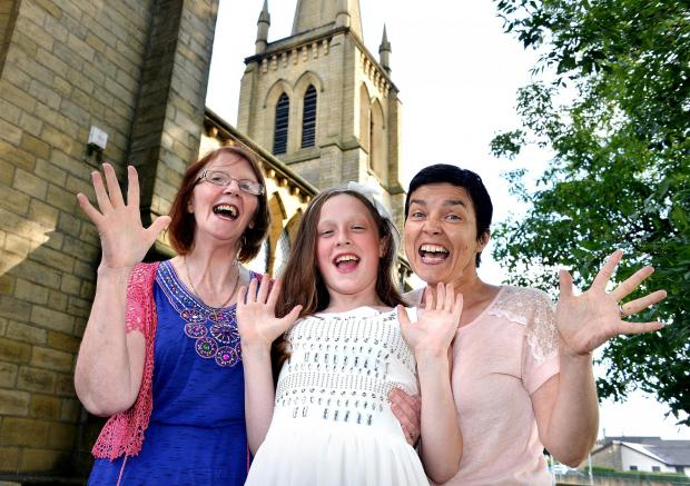 Bonnie Priestley, 12, has organised a summer fair at St John's Church, East Bowling. She is pictured with her grandmother, June Priestley, and church member Sandra Foxcroft