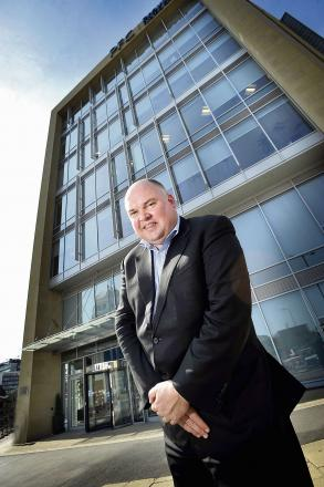 Peter Crook CEO of Provident Financial outside the Bradford HQ