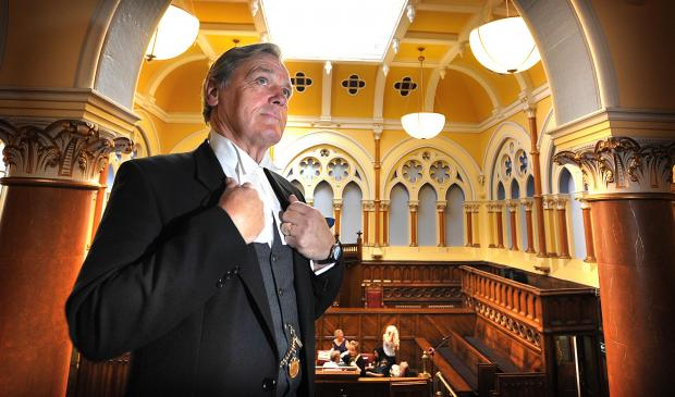 Actor Harry Atkins plays a solicitor as he recreates a 1950s court case in City Hall's old law courts during he heritage open day two years ago