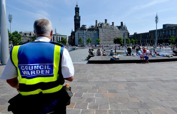 A council warden patrols City Park as part of a crackdown on street drinking