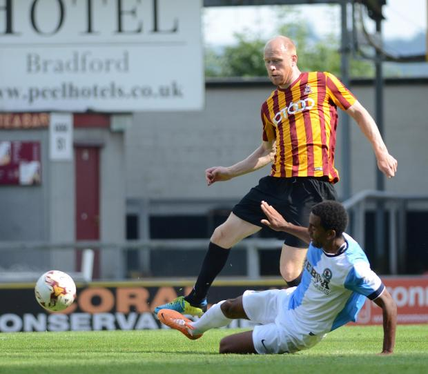 Jason Kennedy is challenged by Blackburn's Lee Williamson during Saturday's friendly at Valley Parade