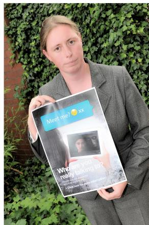 Detective Chief Inspector Sue Jenkinson holds up the campaign poster