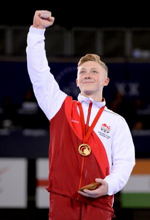 England's Nile Wilson with his gold medal won in the men's horizontal bar final