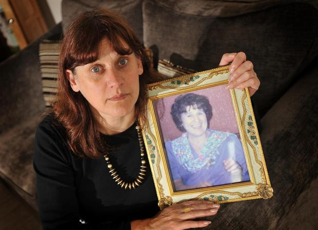 OUTRAGED: Sandha Robertson with a picture of her former mother-in-law, Mary Robertson