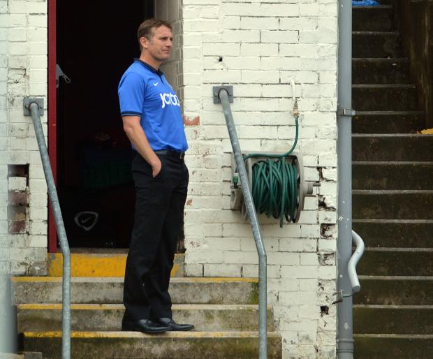HOT RECEPTION: Phil Parkinson waits to tear into his players outside the Valley Parade changing rooms after a lacklustre first-half showing against Hartlepool on Saturday. It did the job, with a much-improved performance after the break in a 1-1 friendly