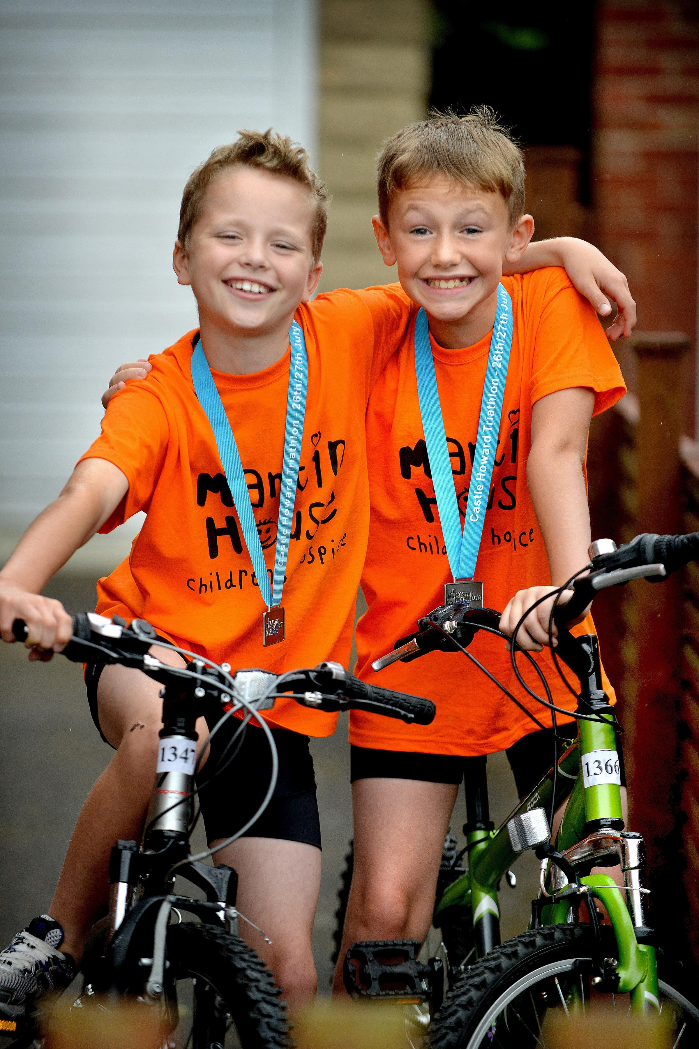 VIDEO: Sport-mad lads, 10, take on triathlon for hospice