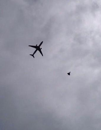 The plane escorted by an RAF fighter