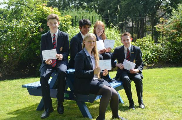 NUMBER CRUNCHERS: Gold and Bronze winners, from left back, Ben Cooper, Jayvian Mavi, Isabelle Williams and, front, Harrison Layden-Fritz and Nichola Backhouse