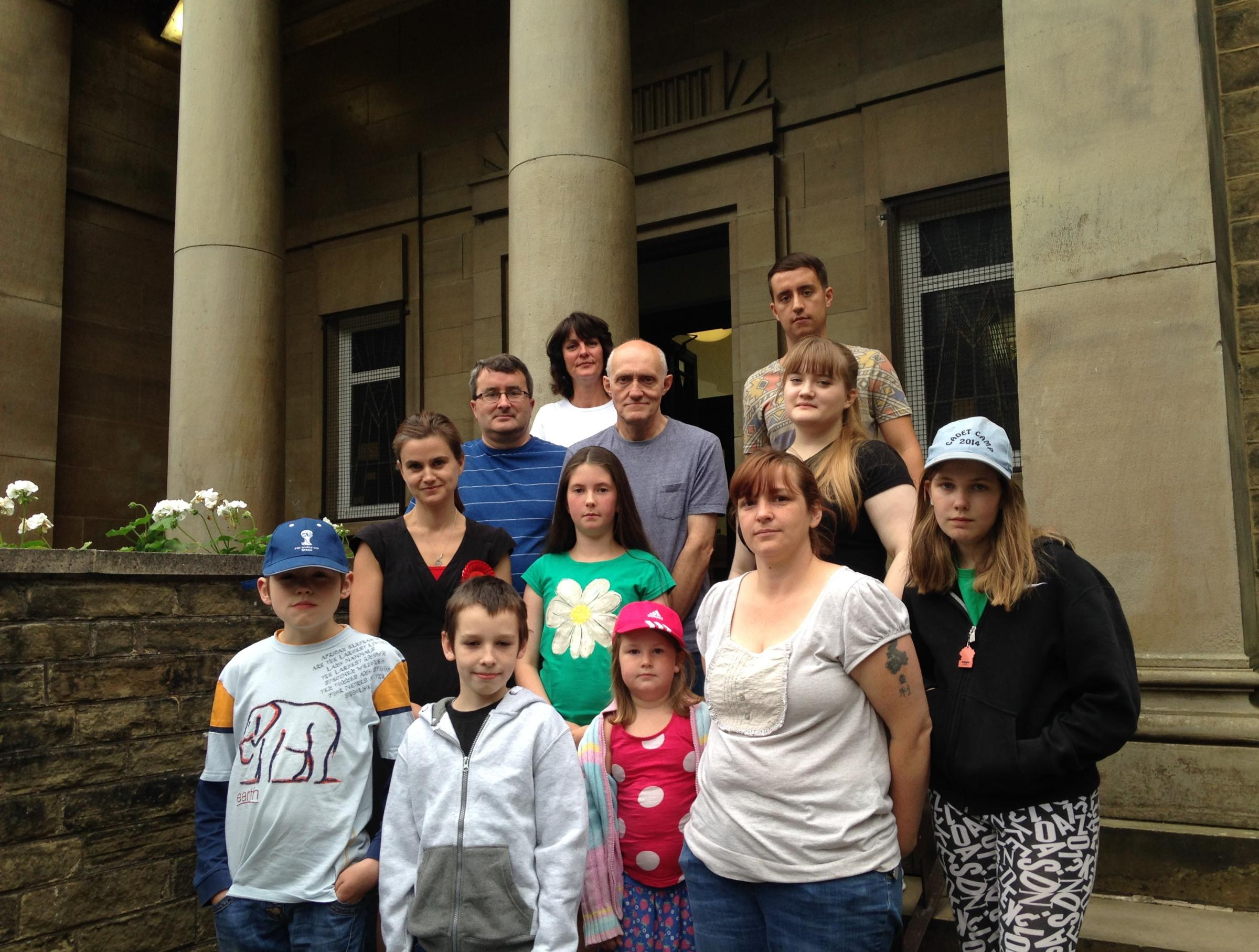 DETERMINED: A group of campaigners outside Cleckheaton Library