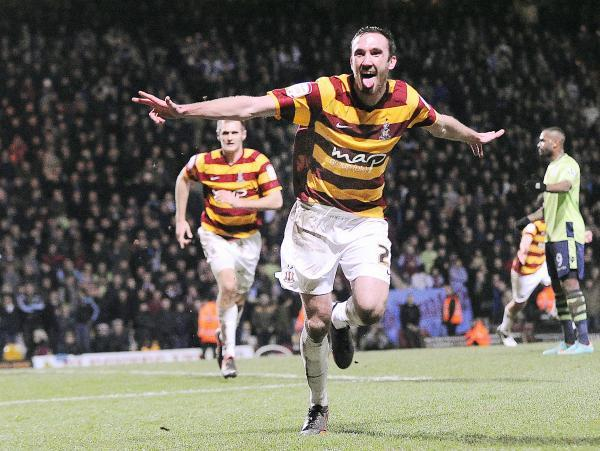 MAGIC MOMENT: Rory McArdle wheels away in celebration after scoring against Aston Villa – City's last win in a cup competition