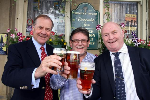 Boltmaker's Arms licensee Phil Booth, centre, enjoys a pint of Boltmaker with Taylor's managing director Charles Dent, left, and head brewer Peter Eells when the beer was unveiled last year