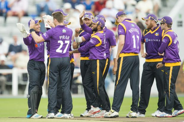 Richard Pyrah, who was the pick of the Yorkshire bowlers with 3-25, is congratulated on dismissing Wayne Madsen