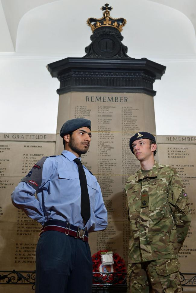 TRIBUTE: Bradford Grammar School cadets Haaris Qureshi, left, and David Fear stand by the war memorial at the school
