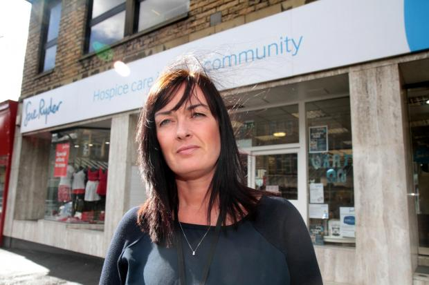 Manorlands shop manager Jackie Burke outside the Cavendish Street store where burglars stole takings