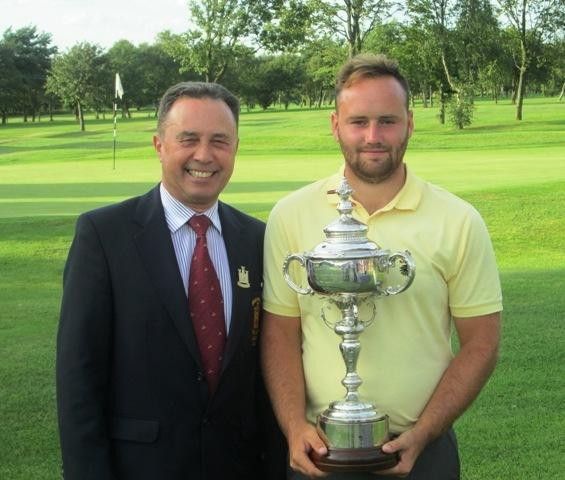Will Whiteoak receives the Macgill Challenge trophy from Middlesbrough captain Ken Saint