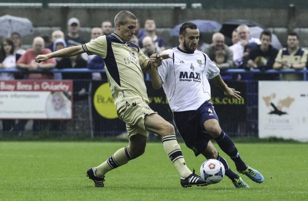 LOWE BLOW: Guiseley's Danny Lowe, right, is one of the Guiseley players who were injured at Farsley