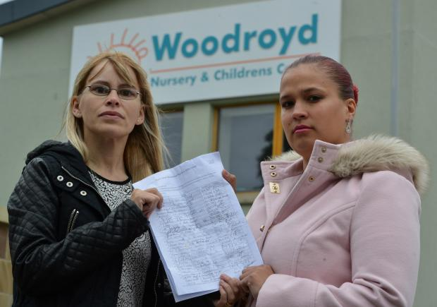 PROTEST: Parents Helen Davies and Tanya Henderson with the petition they hope will save the baby room at Woodroyd Nursery in Bradford