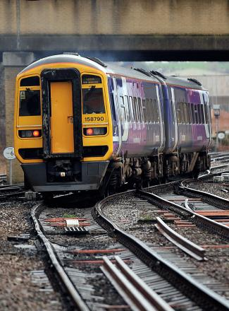A train service bound for Leeds departs from Bradford Interchange