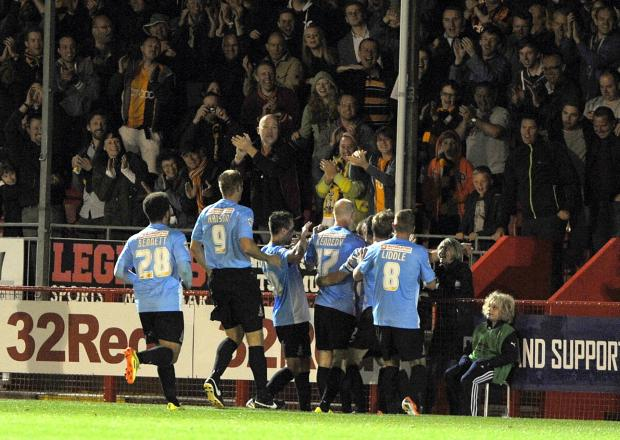 City players celebrate their second goal scored by Billy Knott