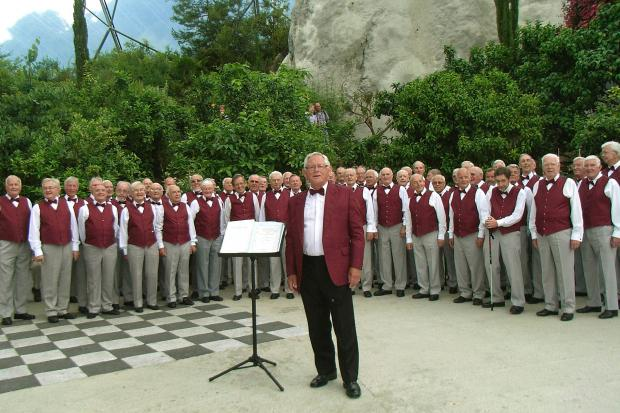 Long serving musical director, Alan Clark, pictured with other members of Steeton male Voice Choir when they sang at the Eden Project in Cornwall