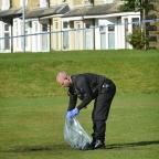 Bradford Telegraph and Argus: PROBE: Police examine the area where the man was found