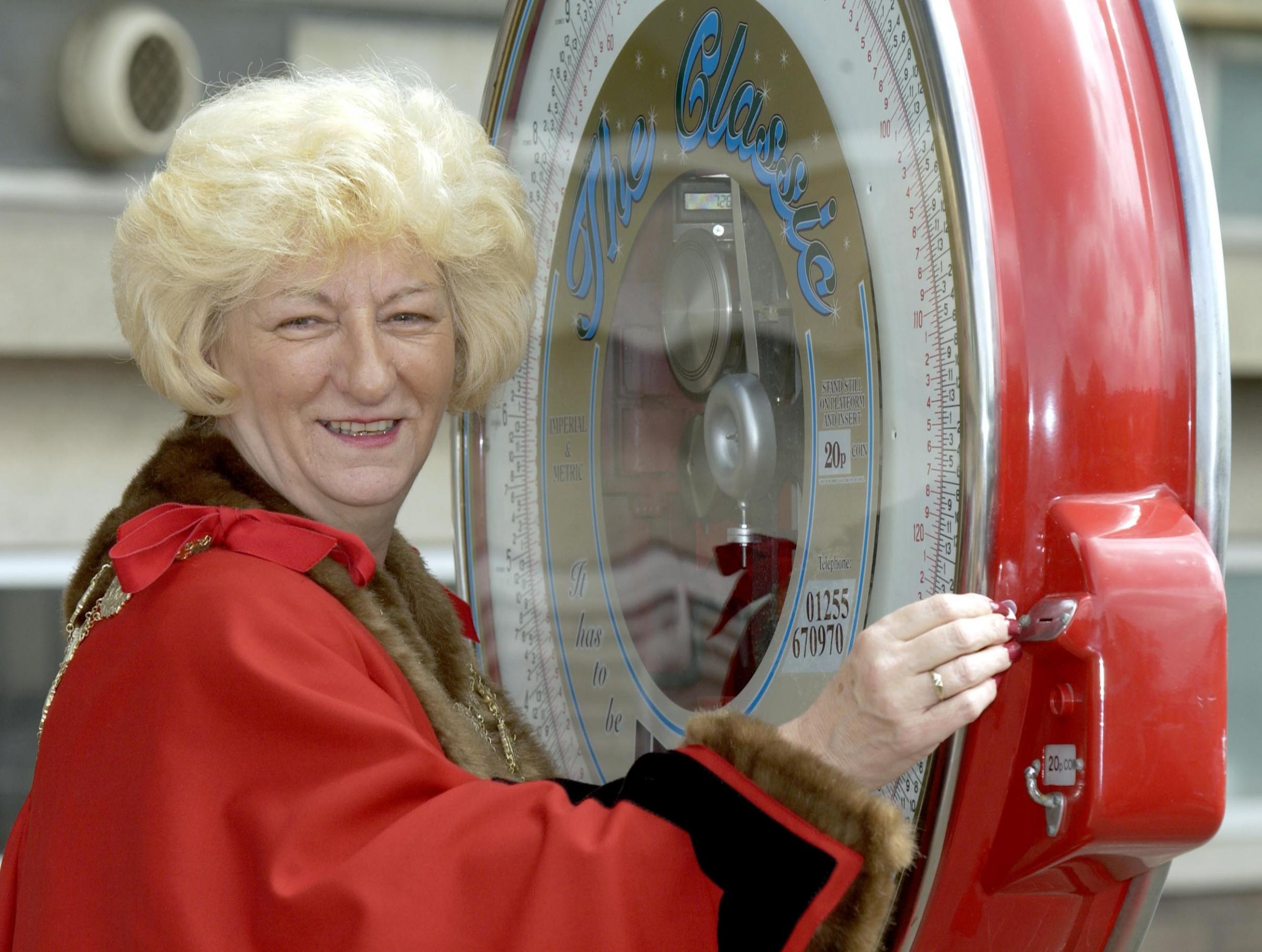 Margaret Bates, then Mayor of Kirklees, performs a civic duty in 2002 to celebrate Cleckheaton winning the weight of the mayor in chocolate