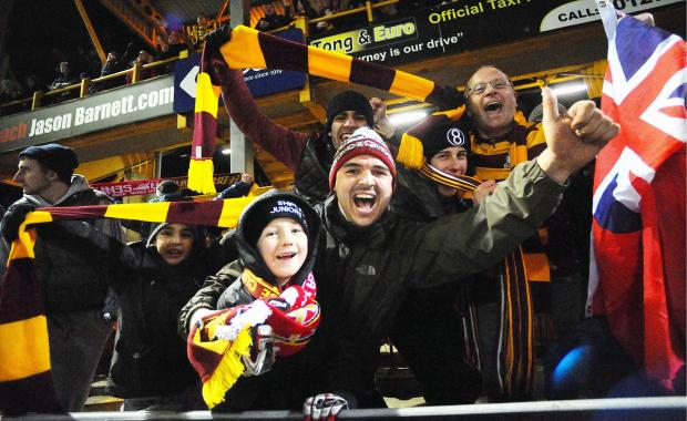 City fans celebrate after Valley Parade's largest crowd in over half a century saw the hosts stun Arsenal in the Capital One Cup two seasons ago